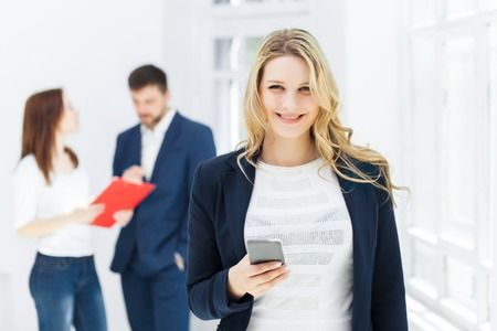 phonecall: Portrait of businesswoman talking on mobile phone in office