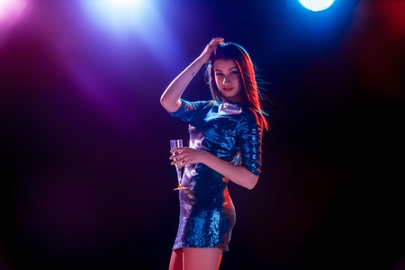 dancing club: Party, holidays, celebration, nightlife and people concept - smiling young beautiful girl dancing in club