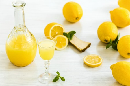 liqueur: The italian traditional liqueur limoncello with lemon Stock Photo