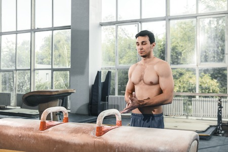brawny: The sportsman the guy before difficult exercise, sports gymnastics Stock Photo