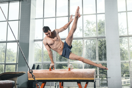 boy gymnast: The sportsman the guy performing difficult exercise, sports gymnastics