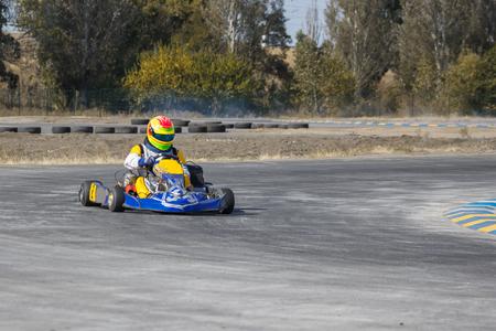 kart: Karting - driver in helmet driving on kart circuit