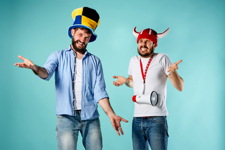suitor: The two football fans with mouthpiece over blue background
