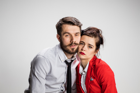 weary: The weary business man and woman on a gray background