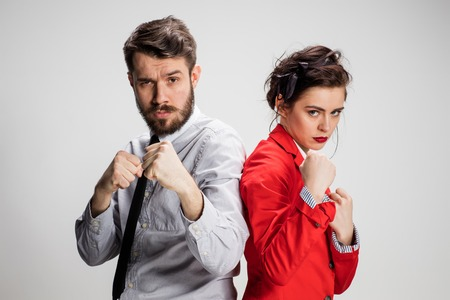 militant: The militant business man and woman on a gray background