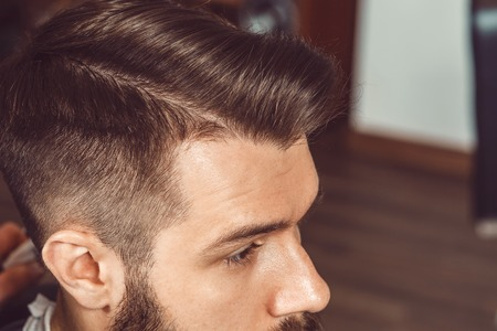 the profile of young man with a trendy hairstyles stock photo