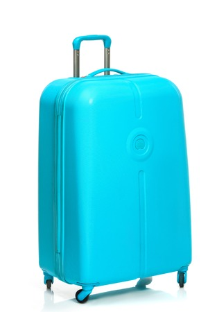 The modern large suitcase on a white background