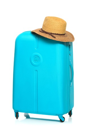 lugage: The modern large blue suitcase and hat on a white background Stock Photo
