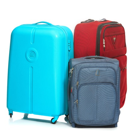 lugage: The modern suitcases on a white background Stock Photo