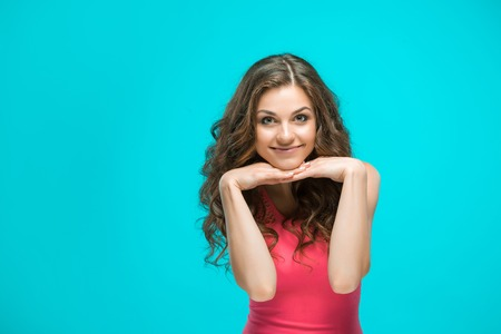 The young womans portrait with happy emotions on gray background Stock Photo