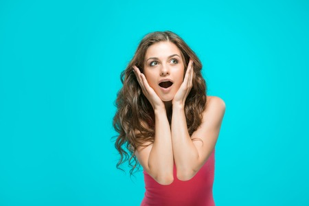 wonderment: The portrait of young woman with shocked facial expression