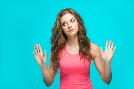 wistful: The young womans portrait with thoughtful emotions on blue background