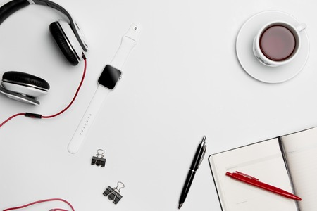 clothes organizer: The cup, pen, and the headphones on white background Stock Photo