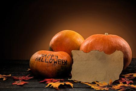 The happy Halloween pumpkins on wooden table