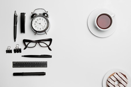clothes organizer: Clock, pen, and glasses on white background
