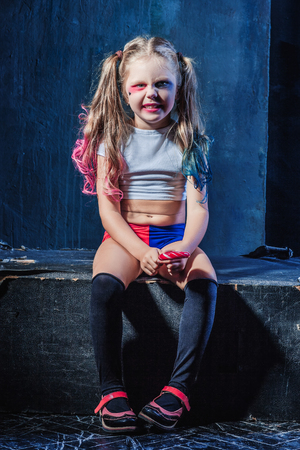 provocative food: The funny crazy girl with candy on dark background