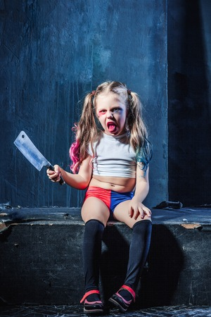 provocative food: Bloody Halloween theme: The funny crasy girl with knife on dark background