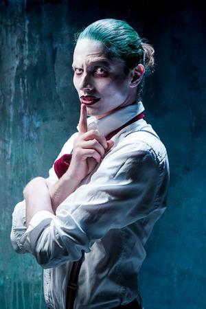 psychopath: Bloody Halloween theme: The crazy joker face on black background Stock Photo