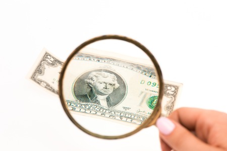 spurious: The two dollars bill and magnifying glass