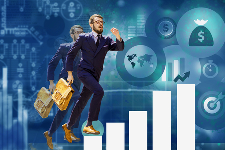 Image of young businessman jumping over steps of a chart or graph. concept of career success Stock Photo