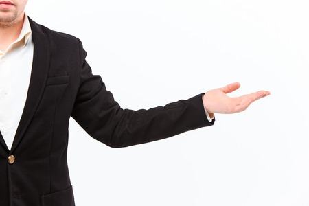 anything: Dressed in a business suit caucasian male hand gesture of asking for the help or showing anything over the dark background