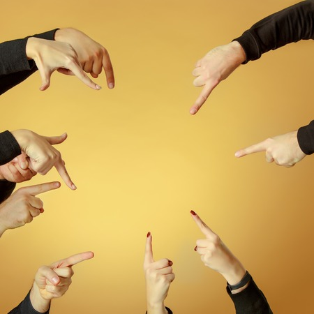 handsign: Many hands pointing ahead or out or inside on orange background