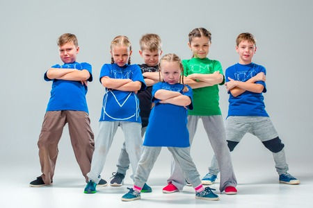 The kids dance school, ballet, hiphop, street, funky and modern dancers on gray studio background 版權商用圖片