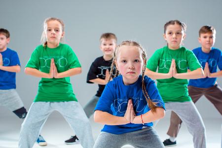 The kids dance school, ballet, hiphop, street, funky and modern dancers on gray studio background 版權商用圖片