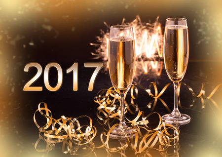 Glasses with champagne against holiday lights - New Year and Christmas background Stock Photo