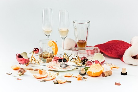 christmas hats: The morning after christmas day, table with alcohol and leftovers from a celebratory feast on gray Stock Photo