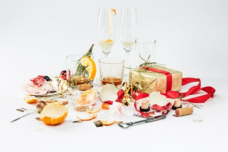 leavings: The morning after christmas day, table with alcohol and leftovers from a celebratory feast on gray Stock Photo