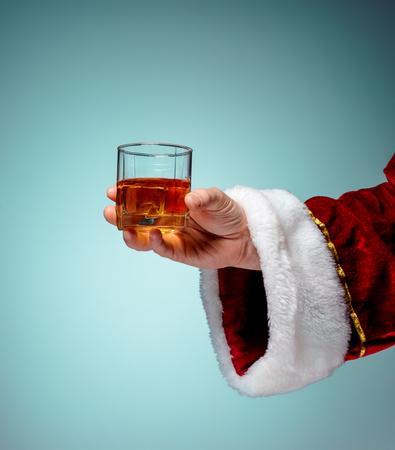 effervescence: Santa Holding with a beer glass over blue background