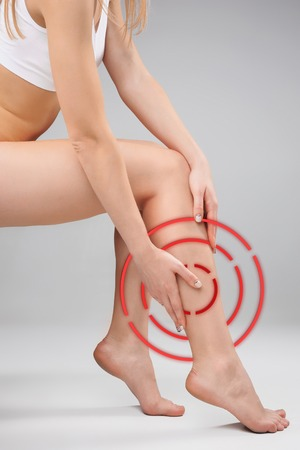 The female legs and hands on white background