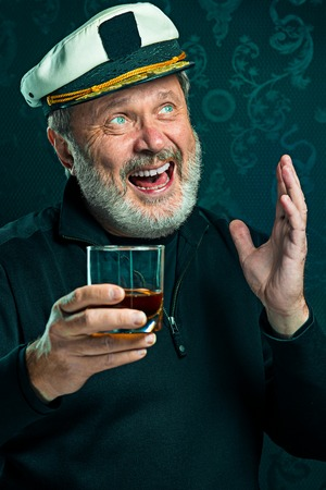 black sweater: Portrait of old captain or sailor man in black sweater