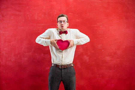 constraining: Young beautiful man with abstract heart