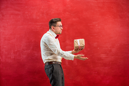 constraining: Young funny man with abstract heart Stock Photo
