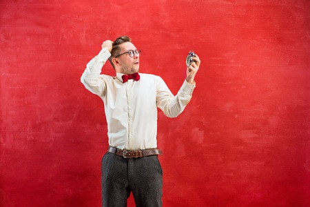 constraining: Young funny man with abstract clock