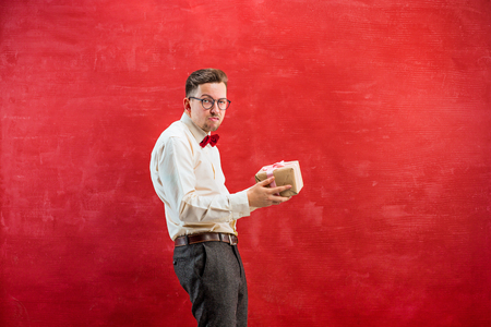 constraining: Young funny man with gift Stock Photo