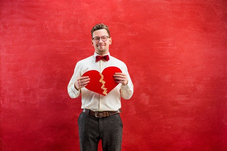 constraining: Young funny man with abstract broken heart