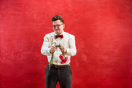 constraining: Young funny man with broken bouquet