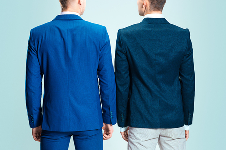 Two young stylish men in a suit. Rear view from the back.
