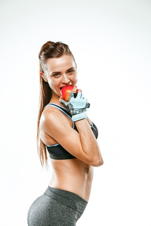 Muscular young woman athlete on white Stock Photo