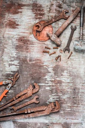 rusty nail: The set of construction tools on wooden table