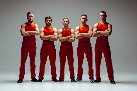 equilibrium: The group of gymnastic acrobatic caucasian men