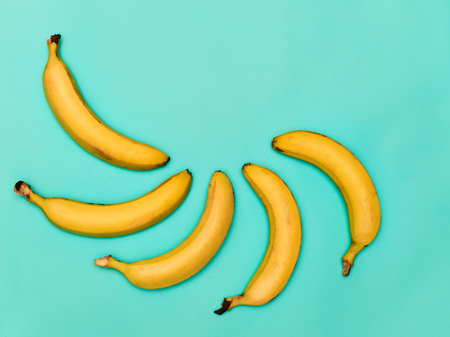 The group of bananas against blue background