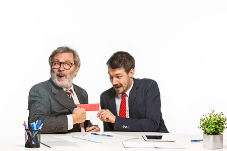 extortion: Concept - corruption. Businessman in a suit taking a bribe
