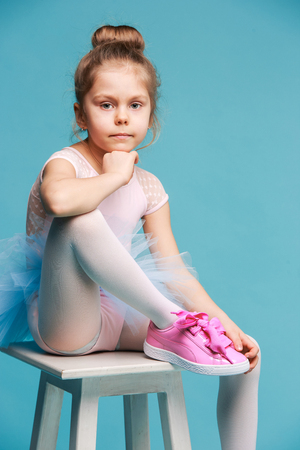 The little balerina dancer on blue background Stock Photo