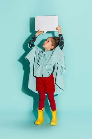 Little girl posing in fashion style wearing autumn clothing. Stock Photo