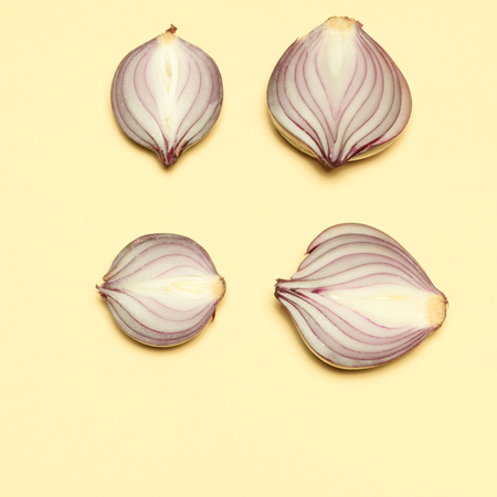 Red onion on a yellow background Stock Photo