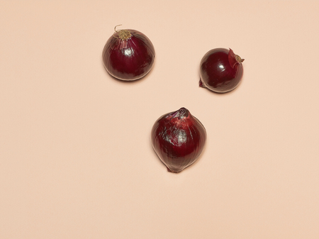 Red onion on a pink background Stock Photo